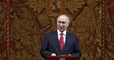 Russian President Vladimir Putin delivers his speech at a gala on the occasion of the New Year at the Bolshoi Theater in Moscow, Russia, Thursday, Dec. 26, 2019. (Mikhail Metzel, Sputnik, Kremlin Pool Photo via AP)