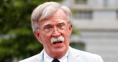 In this July 31, 2019 file photo, then National security adviser John Bolton speaks to media at the White House in Washington. Bolton says he's 'prepared to testify' in Senate impeachment trial if subpoenaed (AP Photo/Carolyn Kaster)