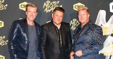 FILE - In this June 6, 2018, file photo, from left, Joe Don Rooney, Jay DeMarcus, and Gary LeVox, of Rascal Flatts, arrive at the CMT Music Awards at the Bridgestone Arena . (AP Photo/Al Wagner, File)