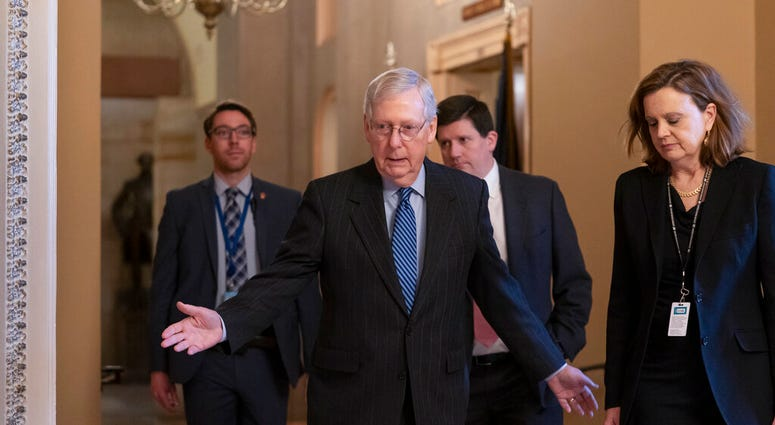 Senate Majority Leader Mitch McConnell, R-Ky., arrives for a closed meeting with fellow Republicans at the Capitol in Washington, Tuesday, Jan. 7, 2020. (AP Photo/J. Scott Applewhite)