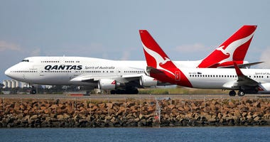 - In this Aug. 20, 2015 file photo, two Qantas planes taxi on the runway at Sydney Airport in Sydney, Australia. (AP Photo/Rick Rycroft, File)