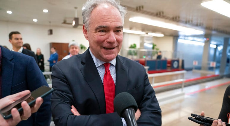 Sen. Tim Kaine, D-Va., a member of the Senate Armed Services Committee and the Foreign Relations Committee, responds to reporters.  (AP Photo/J. Scott Applewhite)
