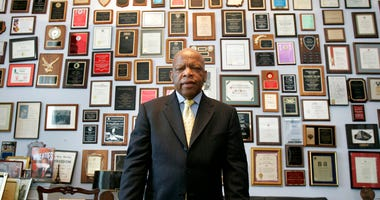 FILE - In this Thursday, May 10, 2007 file photo, U.S. Rep. John Lewis, R-Ga., in his office on Capitol Hill, in Washington.