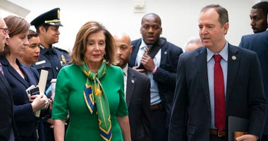 Speaker of the House Nancy Pelosi, D-Calif., joined by House Intelligence Committee Chairman Adam Schiff, D-Calif., leaves a closed-door meeting with the Democratic Caucus at the Capitol, Tuesday, Jan. 14, 2020. (AP Photo/J. Scott Applewhite)