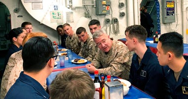 Marine Gen. Frank McKenzie, the top U.S. commander for the Middle East, meets with sailors and Marines on the USS Bataan amphibious assault ship on Thursday, Jan. 23, 2020, in the northern Red Sea. (AP Photo/Lolita Baldor)