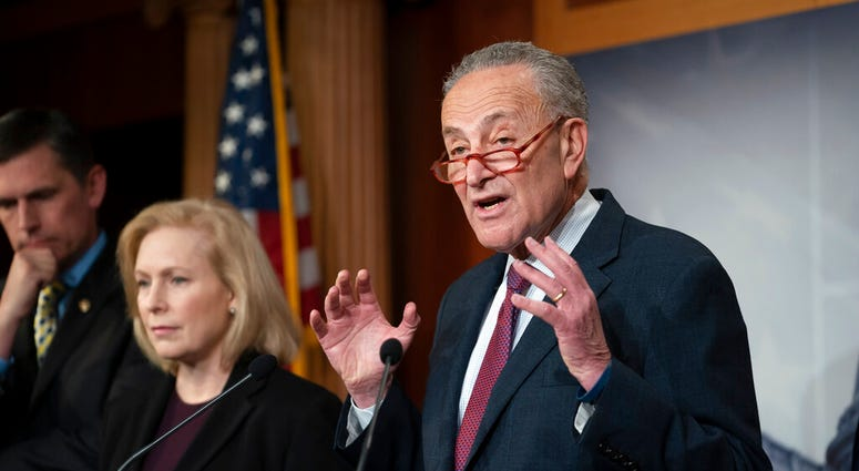 Senate Minority Leader Chuck Schumer, D-N.Y., alks to reporters about the impeachment trial of President Donald Trump on charges of abuse of power and obstruction of Congress, in Washington, Friday, Jan. 24, 2020. (AP Photo/J. Scott Applewhite)