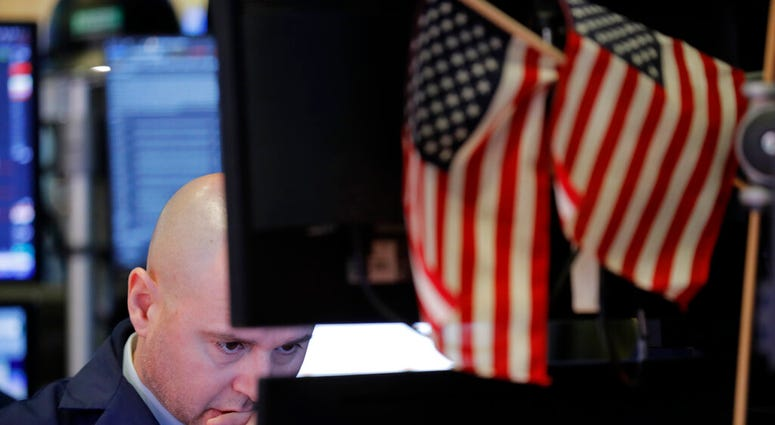 In this Jan. 8, 2020, file photo a trader works on the floor at the New York Stock Exchange in New York. (AP Photo/Seth Wenig, File)