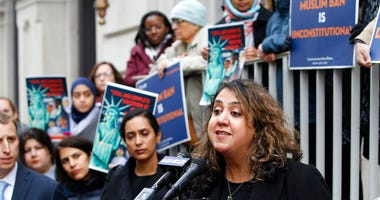 Plaintiff in the Muslim Ban Lawsuit, Mana Kharrazi, right, speaks during a rally outside the U.S. 4th Circuit Court of Appeals Tuesday Jan 28, 2020, in Richmond, Va.  (AP Photo/Steve Helber)