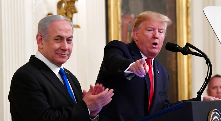President Donald Trump speaks during an event with Israeli Prime Minister Benjamin Netanyahu in the East Room of the White House in Washington, Tuesday, Jan. 28, 2020. (AP Photo/Susan Walsh)