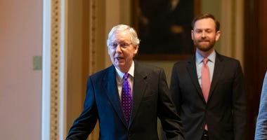 Senate Majority Leader Mitch McConnell of Ky., left, walks from the Senate Floor on Capitol Hill, Tuesday, Feb. 4, 2020 in Washington. (AP Photo/Alex Brandon)