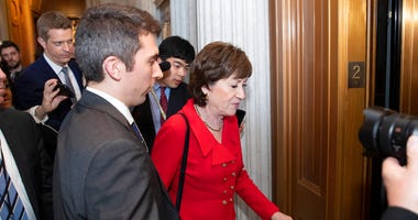 Sen. Susan Collins, R-Maine, heads to a waiting elevator on Capitol Hill, Tuesday, Feb. 4, 2020, in Washington. (AP Photo/Alex Brandon)