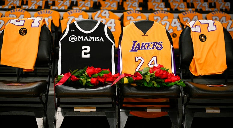 FILE - In this Jan. 31, 2020, file photo, the jerseys of late Los Angeles Laker Kobe Bryant, right, and his daughter Gianna are draped on the seats the two last sat on at Staples Center. (AP Photo/Kelvin Kuo, File)