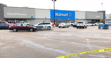 Police tape blocks off a Walmart store parking lot in Forrest City, Ark., on Monday, Feb. 10, 2020. (AP Photo/Adrian Sainz)