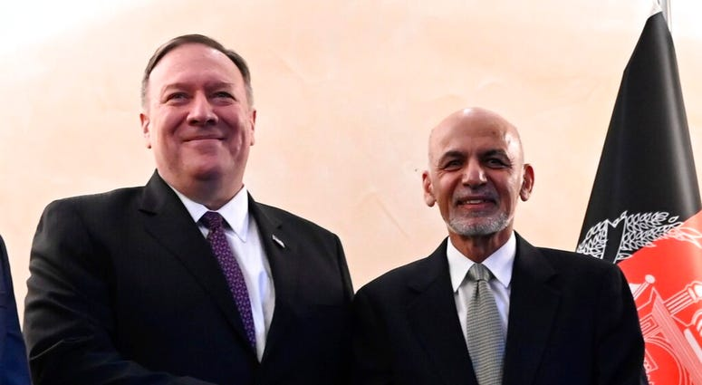 US Secretary of State Mike Pompeo, left, shakes hands with Afghan President Ashraf Ghani,during the 56th Munich Security Conference (MSC) in Munich, southern Germany, on Friday, Feb. 14, 2020. (Andrew Caballero-Reynolds/Pool photo via AP)