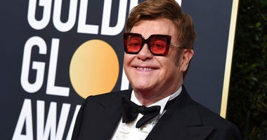 FILE - In this Jan. 5, 2020 file photo, Elton John arrives at the 77th annual Golden Globe Awards at the Beverly Hilton Hotel, in Beverly Hills, Calif. (Photo by Jordan Strauss/Invision/AP, File)