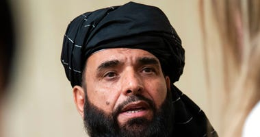 In this May 28, 2019 file photo, Suhail Shaheen, spokesman for the Taliban's political office in Doha, speaks to the media in Moscow, Russia. (AP Photo/Alexander Zemlianichenko, File)