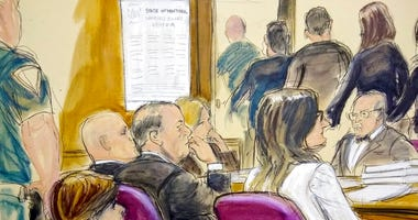 In this courtroom drawing, Harvey Weinstein, center, sits at the defense table surrounded by his attorneys as jurors file out of the courtroom. (Elizabeth Williams via AP)