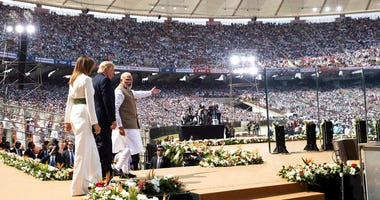"U.S. President Donald Trump, first lady Melania Trump, and Indian Prime Minister Narendra Modi arrive for a ""Namaste Trump,"" event at Sardar Patel Stadium, Monday, Feb. 24, 2020, in Ahmedabad, India. (AP Photo/Alex Brandon)"