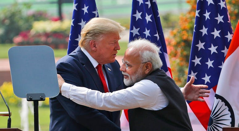 U.S. President Donald Trump and Indian Prime Minister Narendra Modi embrace after giving a joint statement in New Delhi, India, Tuesday, Feb. 25, 2020. (AP Photo/Manish Swarup)
