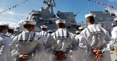 FILE - In this Saturday, July 27, 2019, file photo, sailors stand during a commissioning ceremony for the U.S. Navy guided missile destroyer USS Paul Ignatius, at Port Everglades in Fort Lauderdale, Fla.
