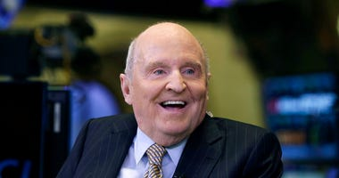 In this Oct. 22, 2013 file photo, former Chairman and CEO of General Electric Jack Welch appears on CNBC on the floor of the New York Stock Exchange. (AP Photo/Richard Drew, File)