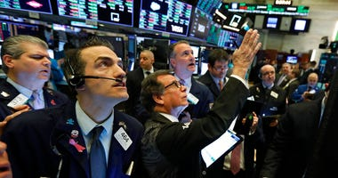 Traders gather at a post on the floor of the New York Stock Exchange, Wednesday, March 4, 2020. Stocks are surging in early trading on Wall Street, led by health care stocks after Joe Biden scored a number of Super Tuesday wins.