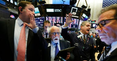 New York Stock Exchange Floor Governor Brendan Connolly, left, works with traders Peter Tuchman, John Panin and Sal Suarino, second left to right, on the floor of the NYSE, Monday, March 9, 2020. (AP Photo/Richard Drew)