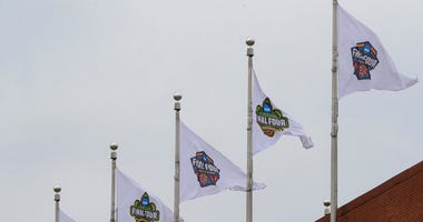 Final Four flags fly over the national office of the NCAA in Indianapolis, Thursday, March 12, 2020. (AP Photo/Michael Conroy)