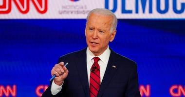 In this March 15, 2020, photo, Sen. Bernie Sanders, I-Vt., and former Vice President Joe Biden, participate in a Democratic presidential primary debate at CNN Studios in Washington. (AP Photo/Evan Vucci)