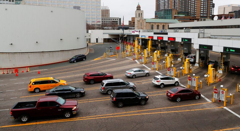 Vehicles enter the United States as a minivan drives to Canada in the Detroit-Windsor Tunnel in Detroit, Monday, March 16, 2020. (AP Photo/Paul Sancya)