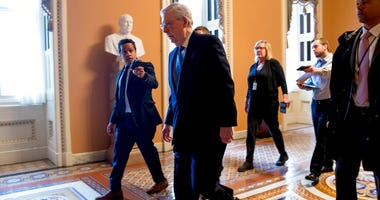 Senate Majority Leader Mitch McConnell of Ky. arrives on Capitol Hill in Washington, Monday, March 23, 2020, as the Senate is working to pass a coronavirus relief bill. (AP Photo/Andrew Harnik)