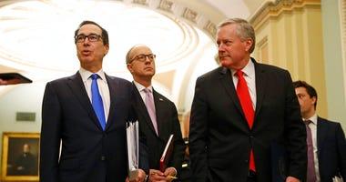 Treasury Secretary Steven Mnuchin, left, accompanied by White House Legislative Affairs Director Eric Ueland and acting White House chief of staff Mark Meadows. (AP Photo/Patrick Semansky)