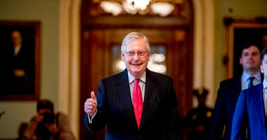 Senate Majority Leader Mitch McConnell of Ky. gives a thumbs up as he leaves the Senate chamber on Capitol Hill in Washington, Wednesday, March 25, 2020.  (AP Photo/Andrew Harnik)