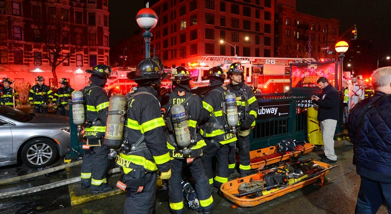 In this image released by the MTA New York City Transit, New York City firefighters assemble at a subway station in New York, Friday, March 27, 2020.
