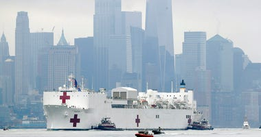 The Navy hospital ship USNS Comfort passes lower Manhattan on its way to docking in New York, Monday, March 30, 2020. (AP Photo/Seth Wenig)