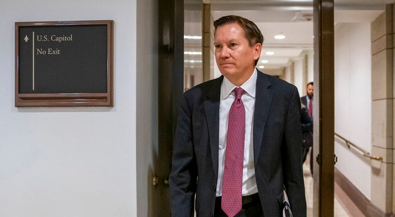 FILE - In this Oct. 4, 2019, file photo, Michael Atkinson, the inspector general of the intelligence community, arrives at the Capitol in Washington for closed-door questioning about a whistleblower complaint that triggered President Donald Trump's impeac