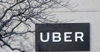 FILE - In this Nov. 15, 2019, file photo an Uber office is seen in Secaucus, N.J.  (AP Photo/Seth Wenig, File)