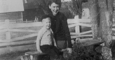"In this image provided by the McConnell Center at the University of Louisville, Mitch McConnell sits with his mother Julia ""Dean"" McConnell on a bench in this image from the mid 1940's in Five Points, Ala.."