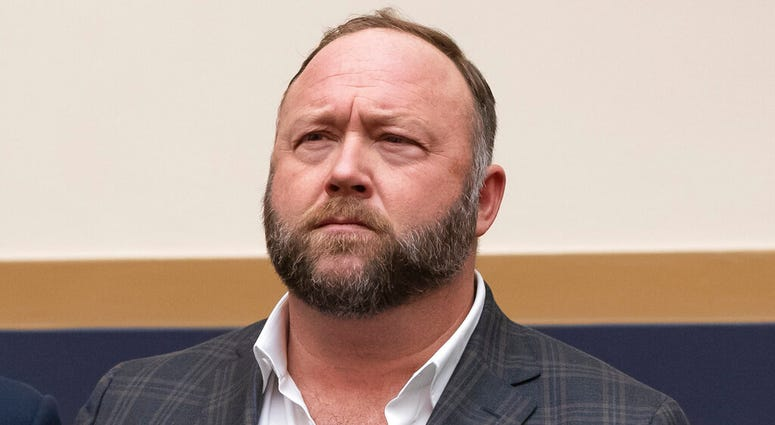 FILE - This Tuesday, Dec. 11, 2018 file photo shows radio show host and conspiracy theorist Alex Jones at Capitol Hill in Washington.