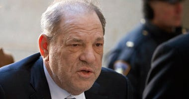 FILE - In this Feb. 21, 2020, file photo, Harvey Weinstein arrives at a Manhattan court as jury deliberations continue in his rape trial in New York.