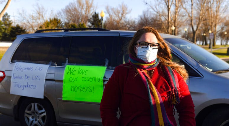 In this Thursday, April 9, 2020 photo, Nancy Reynoza, director of Que Pasa Sioux Falls, who organized a protest in solidarity with Smithfield Food, Inc. (Erin Bormett/The Argus Leader via AP)