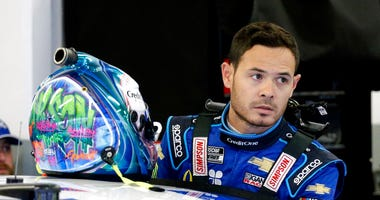 FILE - In this Feb. 14, 2020, file photo, Kyle Larson gets ready to climb into his car to practice for the NASCAR Daytona 500 auto race at Daytona International Speedway in Daytona Beach, Fla.  (AP Photo/Terry Renna, File)