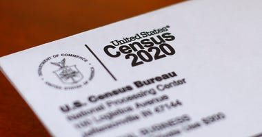 FILE - In this Sunday, April 5, 2020 file photo, An envelope containing a 2020 census letter mailed to a U.S. resident is shown in Detroit. (AP Photo/Paul Sancya, File)