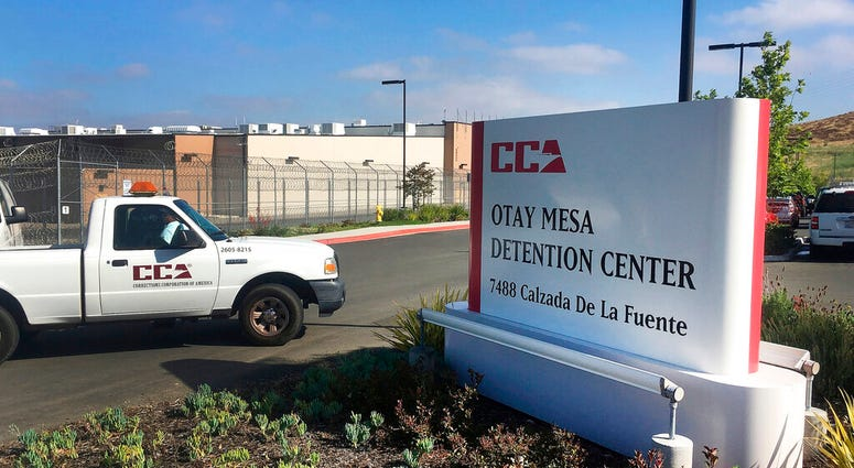 FILE - In this June 9, 2017, file photo, a vehicle drives into the Otay Mesa detention center in San Diego.  (AP Photo/Elliot Spagat, File)