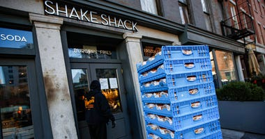 The burger chain Shake Shack says it will return a small-business loan it got to help weather the coronavirus crisis after topping up its funding. (AP Photo/John Minchillo, File)