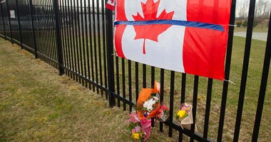 A tribute is displayed Monday, April 20, 2020, at the Royal Canadian Mounted Police headquarters in Dartmouth, Nova Scotia. (Andrew Vaughan/The Canadian Press via AP)