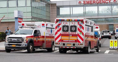 FDNY ambulances are seen entering and leaving the emergency room at Queens Hospital Center, Monday, April 20, 2020, in the Jamaica neighborhood of the Queens borough of New York.  (AP Photo/Mary Altaffer)
