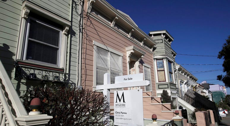 FILE - This Feb. 18, 2020, photo shows a real estate sign in front of a home for sale in San Francisco. (AP Photo/Jeff Chiu, File)