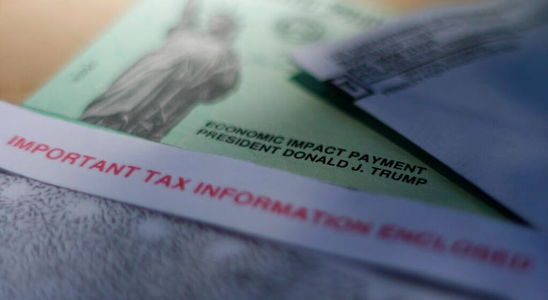 FILE - This April 23, 2020, file photo shows President Donald J. Trump's name printed on a stimulus check issued by the IRS to help combat the adverse economic effects of the new coronavirus outbreak in San Antonio.  (AP Photo/Eric Gay, File)