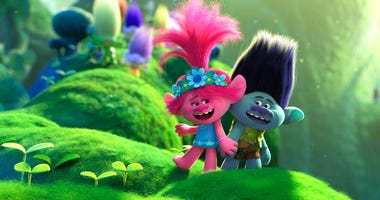 """This image released by DreamWorks Animation shows characters Branch, voiced by Justin Timberlake, right, and Poppy, voiced by Anna Kendrick in a scene from """"Trolls World Tour.""""  (DreamWorks Animation via AP)"""